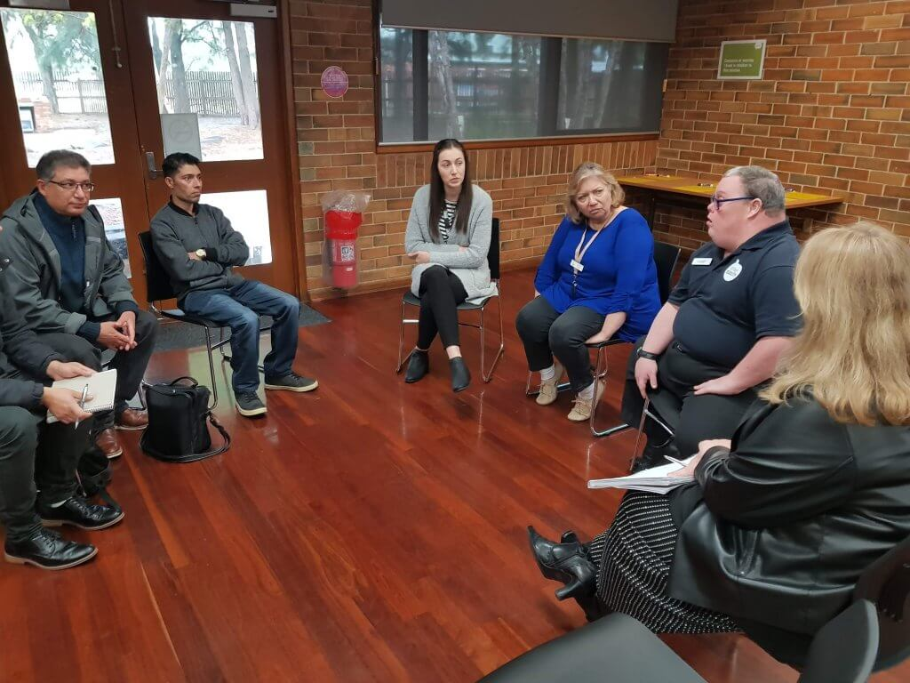 Leigh conducting a workshop to build knowledge in interacting with people with disability
